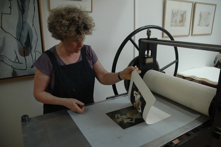 A monotype being removed from the plate after printing.